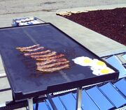 Bacon and eggs cooking on the --Solar Fryer--