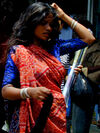 Mumbai woman in red and blue