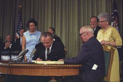 Lyndon Johnson signing Medicare bill, with Harry Truman, 30 July, 1965