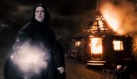 Snape with Hagrid&#39;s hut burning HBP