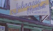 Johnnies Market sign