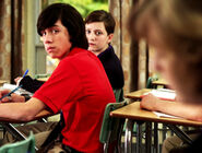 Eli &amp; Adam In Their Degrassi Unifoms In A Degrassi Classroom Looking At Clare
