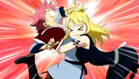 Lucy hugs Natsu