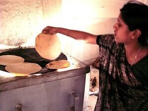 Barli Institute student making chapatis in the Scheffler kitchen