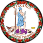 =A circular seal with the words &quot;Virginia&quot; on the top and &quot;Sic Semper Tyrannis&quot; on the bottom. In the center, a woman wearing a blue toga and Athenian helmet stands on the chest of dead man wearing a purple breastplate and skirt. The woman holds a spear and sheathed sword. The man holds a broken chain while his crown lies away from the figures. Orange leaves encircle the seal.