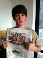 Brad holding Newspaper