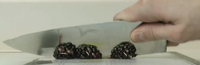 Blackberries being knifed