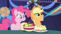 Pinkie Pie eating and Applejack pulling Rainbow's tail S1E1
