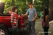 Clare &amp; Alli Talking By Jake&#39;s Truck With Jake Standing In Between The Girls &amp; Bianca Watching From A Distance With Her Arms Crossed &amp; The Girls Far Apart &amp; Alli Apologizing