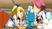 778px-Lucy treating Natsu and Happy to dinner