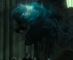 The Death Eater being stunned by Harry.