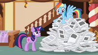Rainbow Dash searching through paper pile S2E23