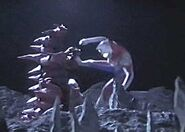 Monsarger battles Ultraman Dyna