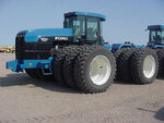 Ford Versatile 9880 4WD w triples - 1995