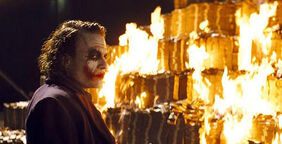 Joker burns money