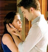 Bella-and-Edward-Romantic-Red-Eyes-Breaking-Dawn-279x300