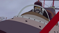 Hiroshi piloting a biplane
