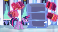 Twilight looking in the empty bookshelf S3E2