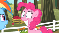 Pinkie Pie smiling at Rainbow Dash S2E15