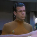 Bajoran medical officer assisting Tahna Los.jpg