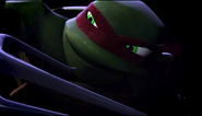 Raph smiling in battle