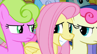 Fluttershy awkwardly smiling at Daisy and Sweetie Drops S2E19