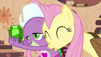 Fluttershy nuzzles Spike S03E11