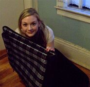 Emily Kinney with a plaid cloth